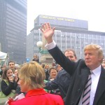Trump Greeting onlookers at Sun Times Building