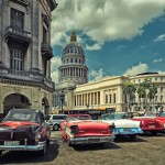 Old American cars in the parking in front of the Capitol