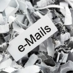 shredded paper tagged with e-mails, symbol photo for data destru